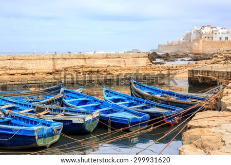 Beautiful blue boats in Essaouira old harbor, Morocco - stock photo