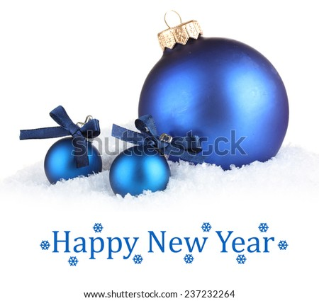 Beautiful blue Christmas balls in snow on light background