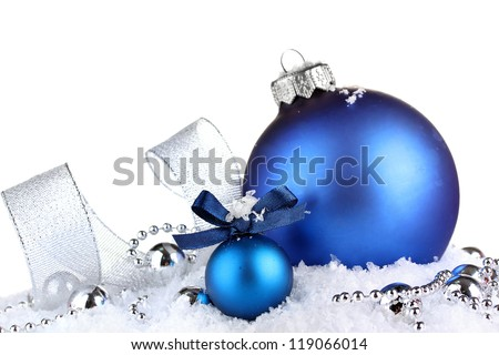 beautiful blue Christmas balls on snow, isolated on white - stock photo