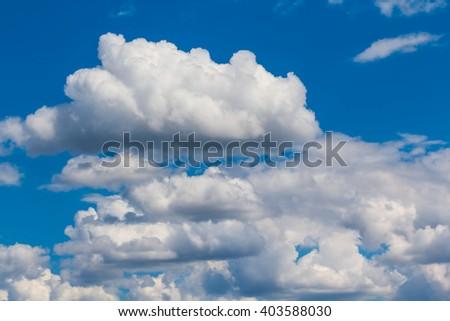 beautiful blue cloudy sky background - stock photo