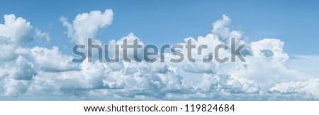 Beautiful blue cloudy sky. Panoramic shot. - stock photo