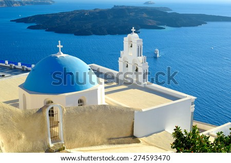 Beautiful blue domed church of Ag. Theodoroi and view into the volcanic caldera, Santorini island,  Aegean Sea, Cyclades, Greece, Europe