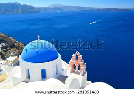 Beautiful blue domed churches in Oia, Santorini,Greece