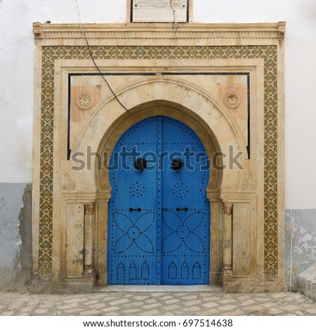Beautiful blue door with decorative nails.Traditional door in Old town of Sousse. Tunisia.