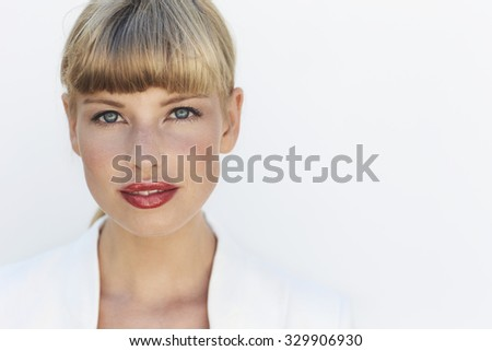 Beautiful blue eyed blond looking at camera