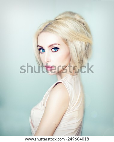beautiful blue eyed blond model looking at camera