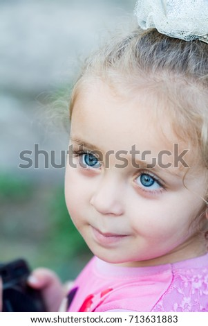Beautiful blue eyed girl looking at the camera