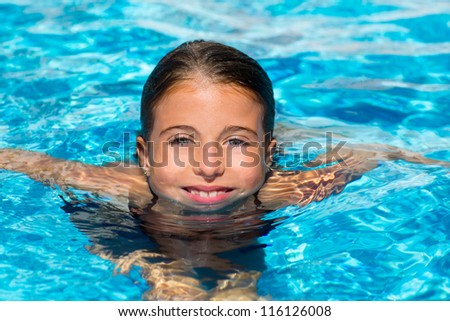 beautiful blue eyes kid girl at the pool with face in water surface - stock photo