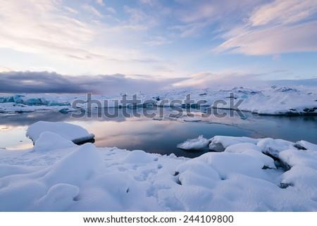 Beautiful blue lagoon with plenty of floating ice on the Jokulsaron lagoon, Iceland - stock photo