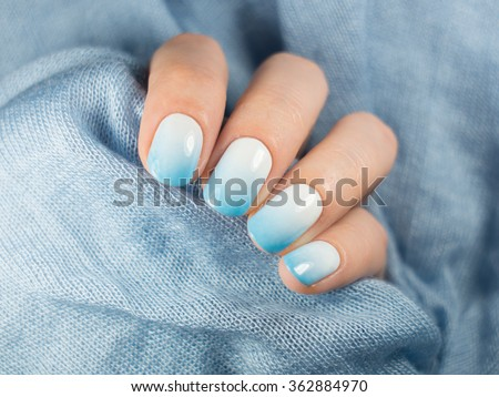 Beautiful blue manicure in light - stock photo