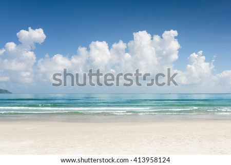 Beautiful blue ocean and tropical white sand beach on sunny summer day. Amazing sea view with azure crystal water. Scenic cloudy sky in background. - stock photo