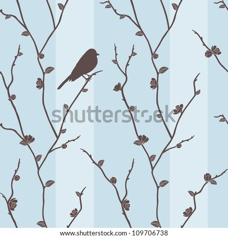 Beautiful blue seamless pattern with a bird on sakura branches - stock photo