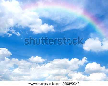 Beautiful blue sky and white clouds with rainbow in good weather and summer day. Photo for background. - stock photo