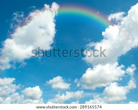 Beautiful blue sky  and  white clouds with rainbow in summer day. Photo for background. - stock photo