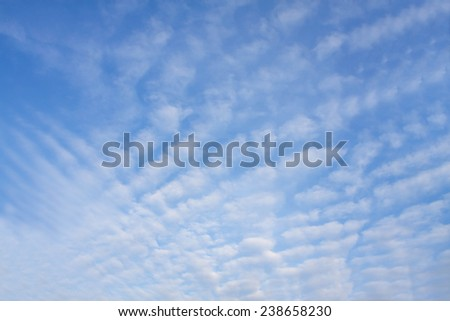 Beautiful blue sky background with tiny white clouds - stock photo