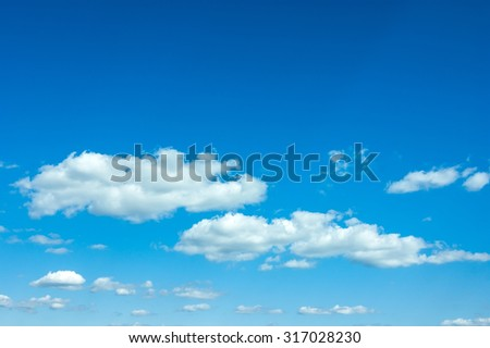 beautiful blue sky with clouds and sun - stock photo