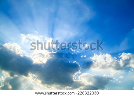 Beautiful blue sky with clouds and sun rays - stock photo