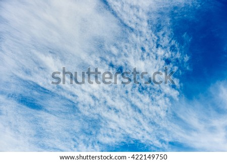 Beautiful blue sky with scattered clouds - stock photo