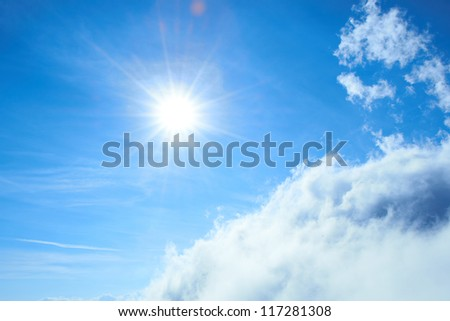 Beautiful blue sky with sun and clouds - stock photo