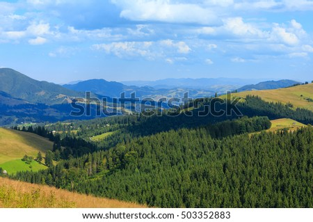 Beautiful blue sky with white cumulus clouds over summer Carpathian mountain (Ukraine, Verkhovyna district, Ivano-Frankivsk region).