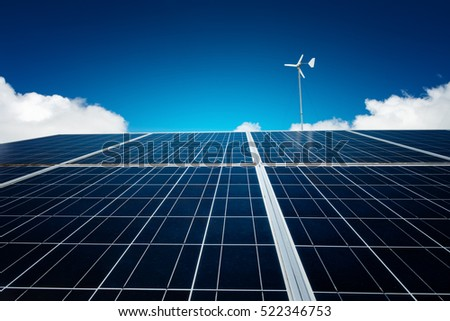 Beautiful blue solar panel with wind turbine on blue sky