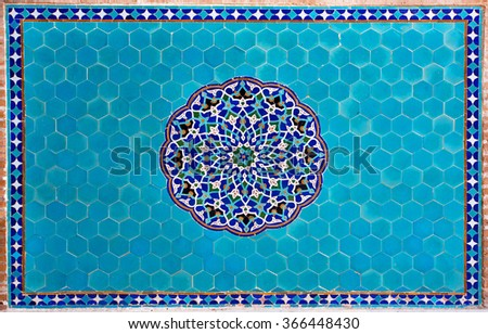 Beautiful blue tiled wall with patterns of Middle East in the historic home of Iran   - stock photo