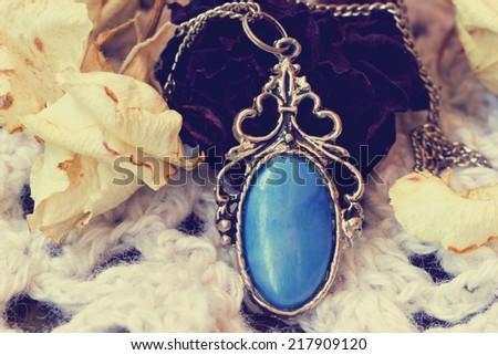 beautiful blue vintage medallion close up - stock photo