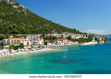 Beautiful blue water and the beach at the foot of the mountains, summer holiday resort