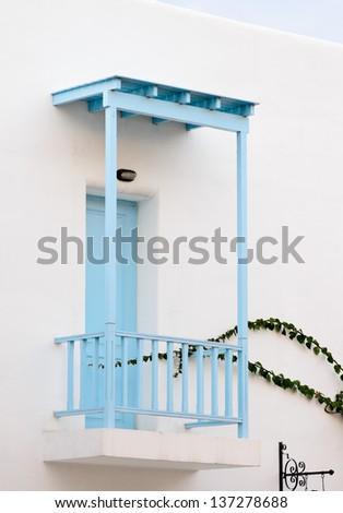 Beautiful blue windows Greek Style on white wall - stock photo
