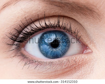 Beautiful blue woman single eye close up - stock photo