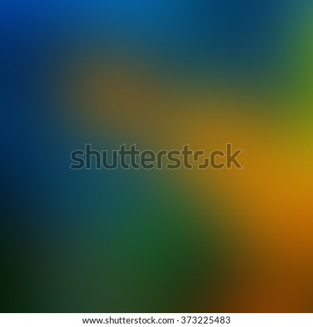 Beautiful blur blue green and yellow background taken from blue and gold macaw bird's feathers, exotic blur texture