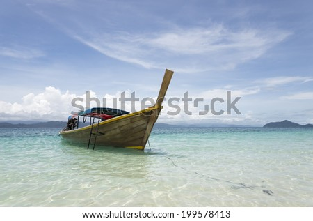 beautiful boat on white sand beach Ranong province Thailand