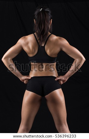 Beautiful body of  fitness woman - dark background