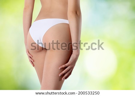 Beautiful body of woman exposing bottom and back side, Isolated on green background - stock photo