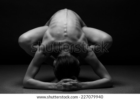Beautiful body of young woman over dark background - stock photo