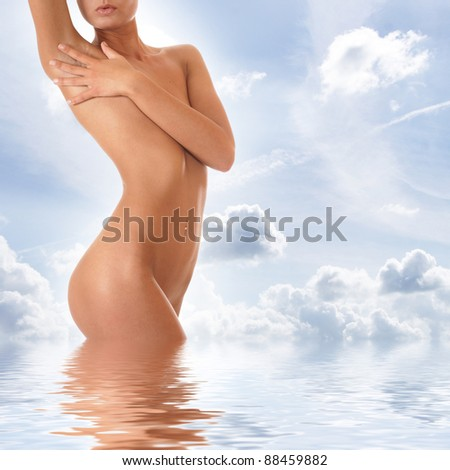 Beautiful body over sky background - stock photo
