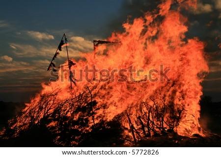 Beautiful Bonfire at dusk - stock photo