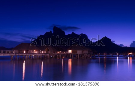 Beautiful Bora Bora and starry sky at night - stock photo