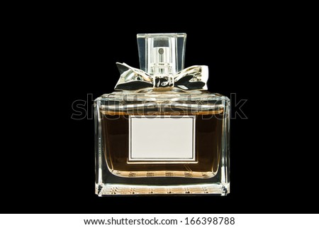 beautiful bottle of perfume on a isolated background with path - stock photo
