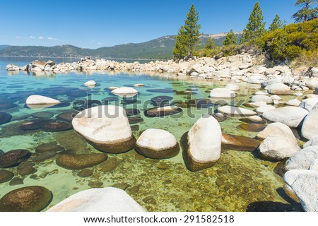 Beautiful boulders and crystal clear water of the lake Tahoe. Hidden Beach, Lake Tahoe - Nevada, USA - stock photo