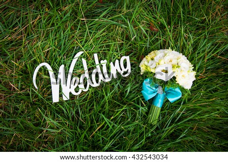 beautiful bouquet and a white wooden sign wedding