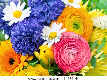 beautiful bouquet of assorted colorful flowers. ranunculus, hyacinth, daisy, gerber - stock photo