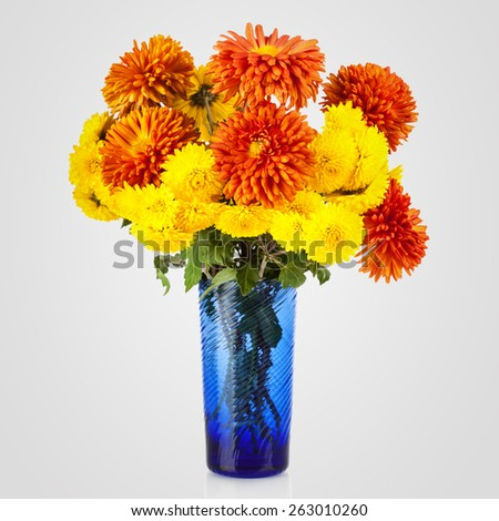 Beautiful bouquet of aster flowers in vase - stock photo