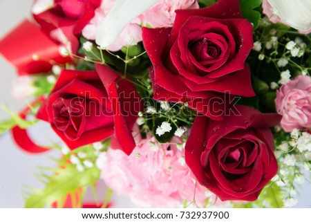 Beautiful bouquet of bright flowers in basket