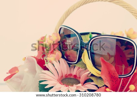 Beautiful bouquet of bright flowers in basket-instagram filter - stock photo