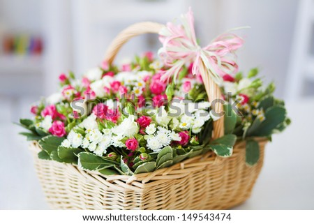 beautiful bouquet of bright flowers in basket isolated on white  rose space bow