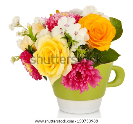 Beautiful bouquet of bright flowers in color mug, isolated on white - stock photo