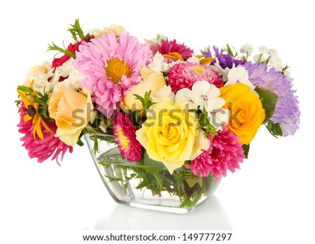 Beautiful bouquet of bright flowers in glass vase, isolated on white