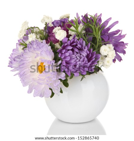 Beautiful bouquet of bright flowers in glass vase, isolated on white - stock photo