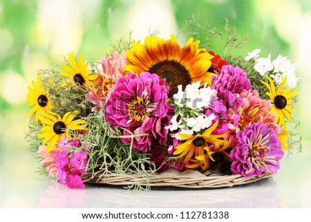 Beautiful bouquet of bright flowers on nature background - stock photo